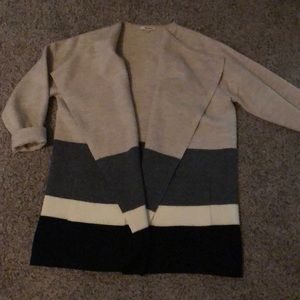 Tan, gray, white and black striped wool sweater
